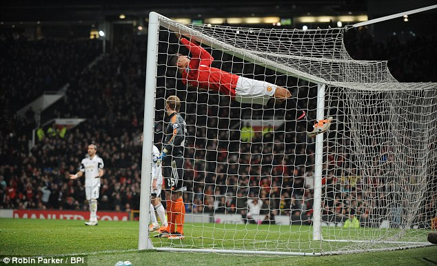 Gaping: Chris Smalling of Manchester United hangs of the crossbar after missing a sitter in the second-half
