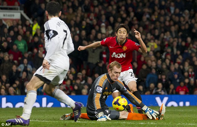 Thwarted: Shinji Kagawa missed a glorious chance to bag a third goal in the closing moments
