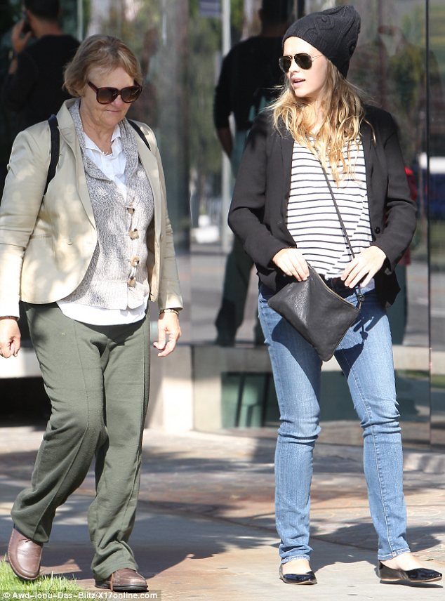 Mother-daughter bonding: Palmer takes her mom Paula Sanders with her to the Bel Bambini baby boutique