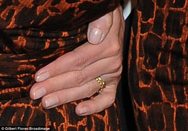 """'Ben has an """"R"""" tattoo in the same place': Hiding under her golden engagement band is now a tattoo of the letter 'B'"""