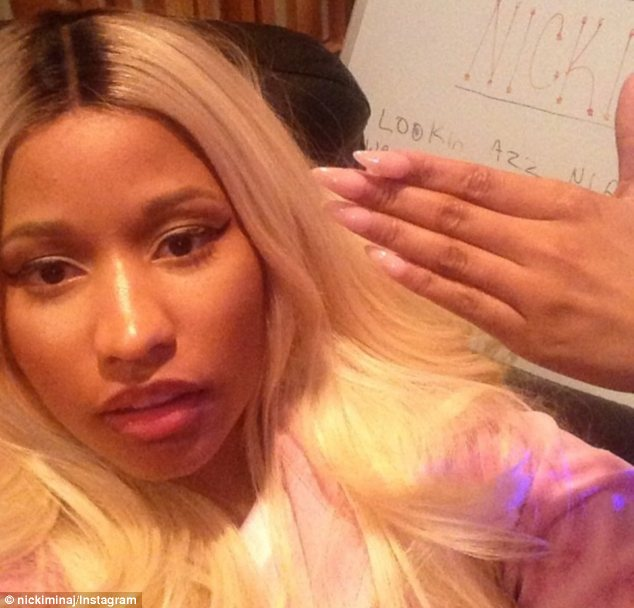 Getting her claws out: Nicki showed off her sharp nails in her first picture before posting a series of racy snaps to her Instagram account