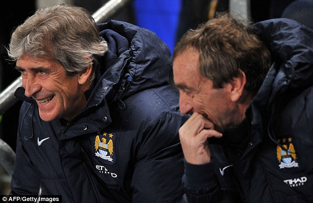All cylinders: Pellegrini (left) has transformed City into a goal machine in all competitions
