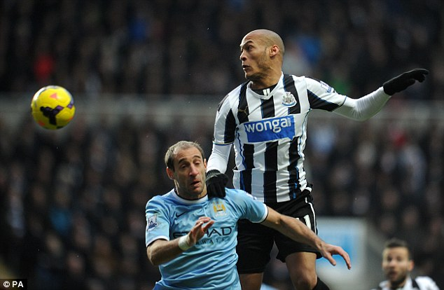 Heads up: Gouffran (right) jumps highest to win a header against City defender Zabaleta (left)