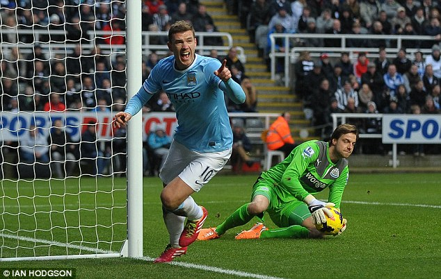 Deadly: Dzeko runs off to celebrate his early goal at St James' Park as Krul clutches the ball