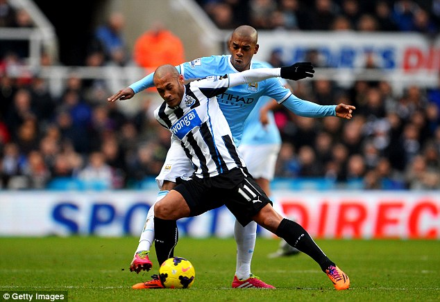 Battle: Newcastle forward Yoan Gouffran (front) tussles for the ball with City midfielder Fernandinho (back)