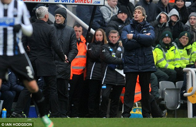 Making a point: Pardew (left) has a disagreement with Manchester City boss Manuel Pellegrini (right) on the touchline after his side's disallowed goal