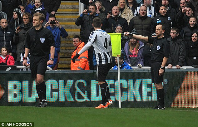 Ruled out: Assistant referee Stephen Child (right) indicates that Tiote's effort is offside because of Yoan Gouffran's position