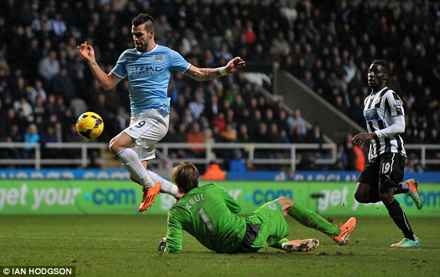 Game over: Alvaro Negredo squeezes the ball past Krul as City hit Newcastle with a late counter attack