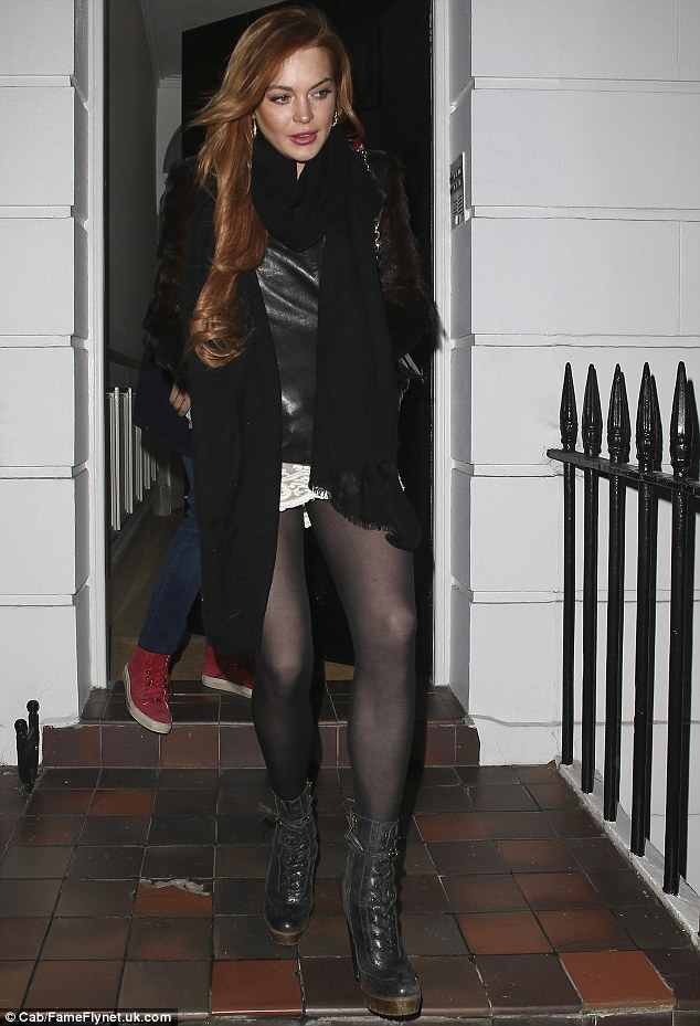 Ready to party: Lindsay showed off her legs in a mini skirt as she left her pals house for a night on the town