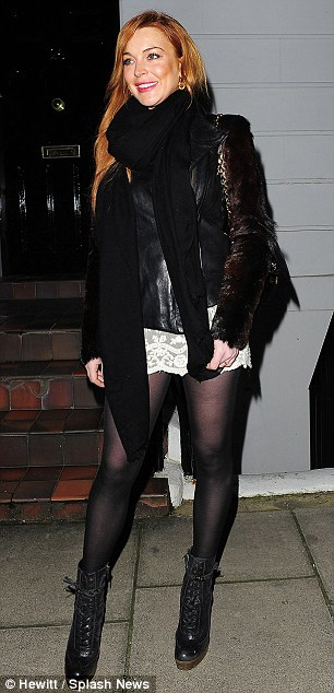 High spirits: The actress was in a good mood as she enjoyed another evening out in London