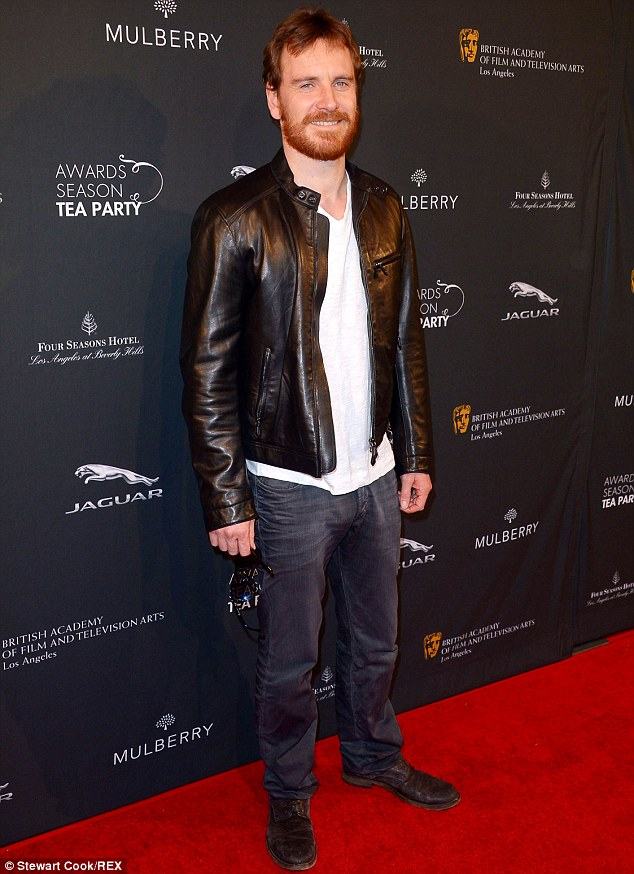 Rugged: Michael Fassbender can play the gentleman but decided to loosen up at the BAFTA Tea Party in jeans, T-shirt and leather jacket