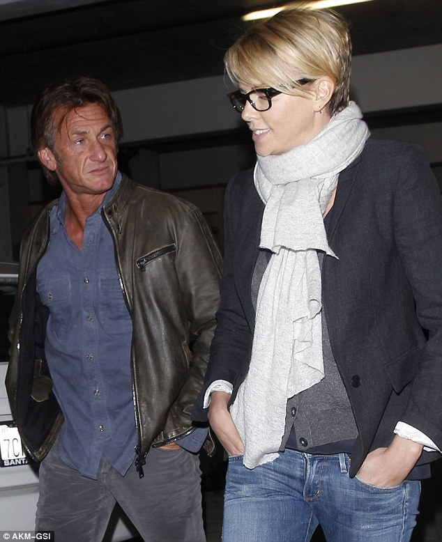 Rumoured romance: Charlize enjoyed a night at the movies with actor Sean on Sunday amid rumours they couple are dating