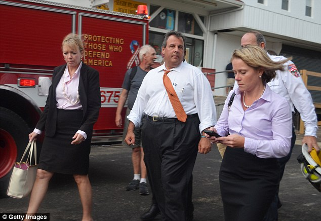 Messages: Bridget Kelly, right, is pictured using her phone as she accompanies Chris Christie hours after receiving emails about the bridge closure on September 12