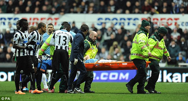 Concern: Nasri was carried off as his team-mates secured a hard-fought 2-0 win at St James' Park