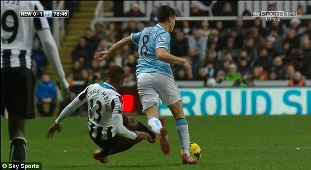 Skipping away: Nasri knocked the ball beyond Yanga-Mbiwa in the 77th minute and was away