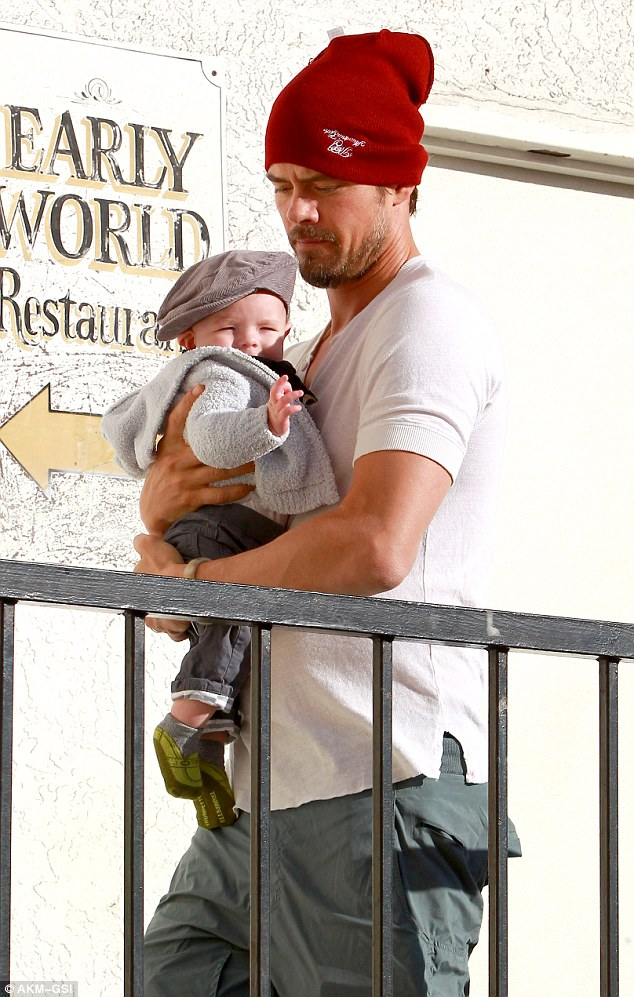 Bonding time: Josh Duhamel carries his five-month-old son Axl into Early World restaurant Sunday morning