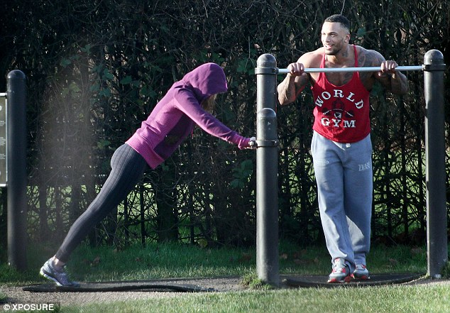 Time to train: David motivates his girlfriend as she works out at the outdoor gym