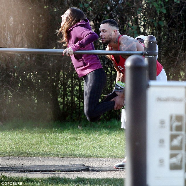 He's got you: Kelly Brook gets some support from new boyfriend David McIntosh as they work out in a local park