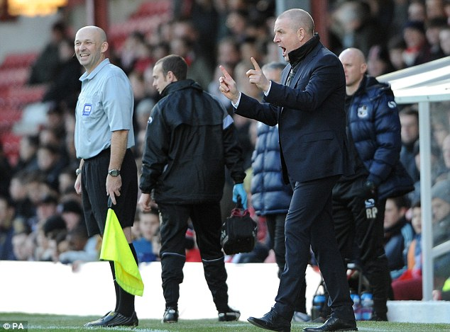 New kid on the block: Brentford are flying at the top of League One with Mark Warburton in charge