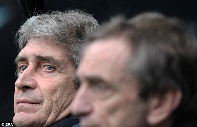 Calmness personified: Manuel Pellegrini's cool demeanour has settled the Manchester City squad down