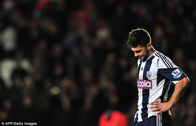 Down: Mel has a tough job on his hands attempting to lift Baggies in the Premier League