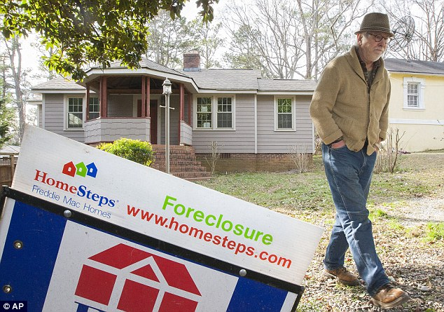 Homeless: John Chambers checks on his former home in the Victory Park Community of Marietta, Georgia. His 186 Parkview Drive home was foreclosed on by Freddie Mac which he is currently fighting in court