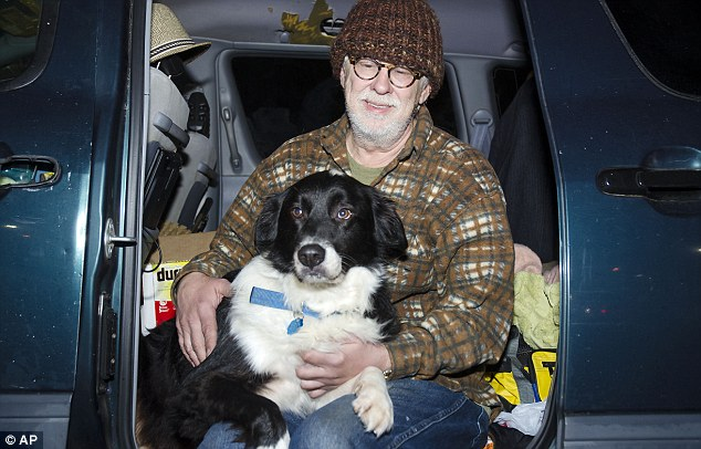 Home: The minivan Chambers and his dog scout have called home for more than a year