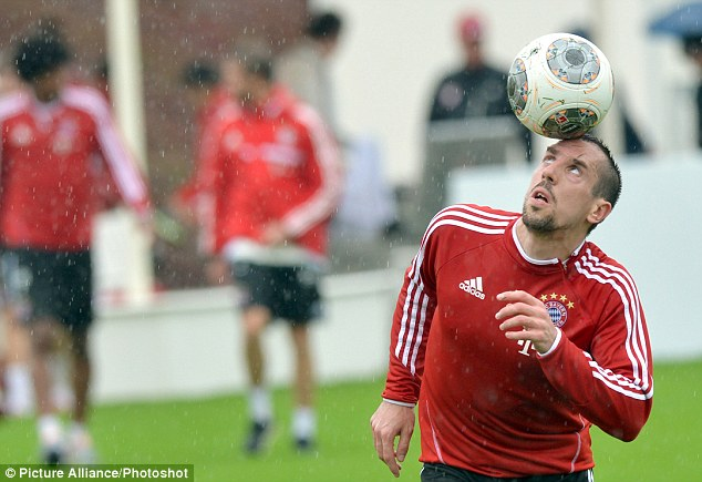 Being Franck: Ribery trains in Doha ahead of the evening that the Ballon d'Or award wil be decided