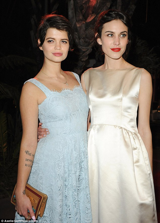 Girly girls: The pair looked particularly classy as they attended the bash arm-in-arm
