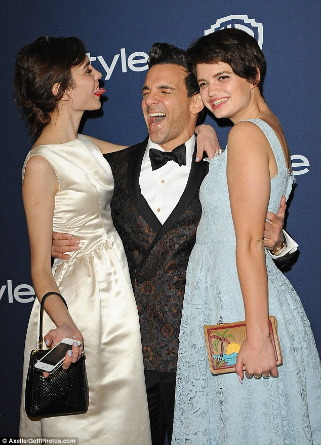Tongue-in-cheek: Alexa is clearly in the party mood as she pulls tongues at handsome fashion guru George Kotsiopoulos