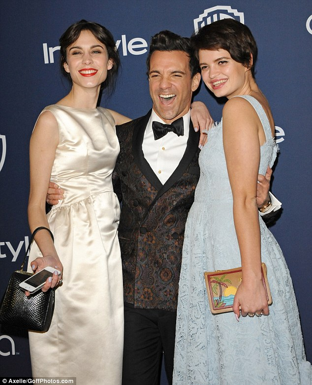 Smile! Pixie Geldof, George Kotsiopoulos and Alexa Chung pose for pictures in their retro outfits