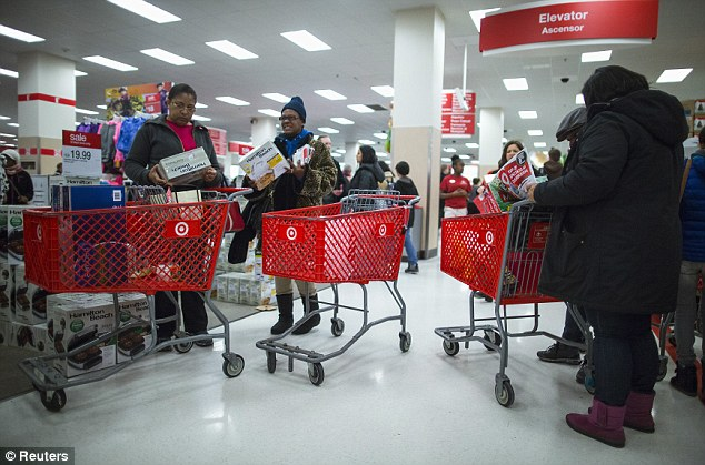 As many as 110 million Target customers, like the ones seen in this stock image, may have been affected by the breach