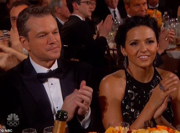Sequins: Michael joked his co-star Matt Damon [pictured with wife Luciana Barroso]didn't win because Michael had more sequins