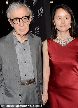 Controversial relationship: Mia and Woody split when she discovered he had a sexual relationship with her adopted daughter Soon-Yi, who he is now married to. Woody and Soon-Yi are pictured here in September