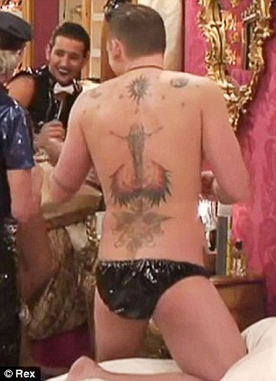 Daring to bare: Lee sported just a pair of tiny PVC pants for the 18 Certificate task on the show on Sunday night