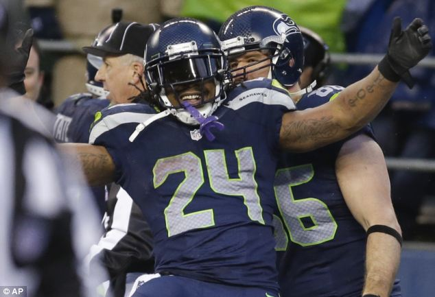 Star player: Lynch ran in two touchdowns during the playoff game against the New Orleans Saints but it was his second 32-yard score which nearly brought the house down
