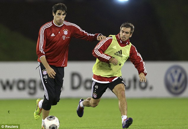 Little and large: Javi Martinez and the diminutive Philipp Lahm (right) compete for the ball
