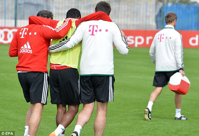 Injury concerns: David Alaba (2L) is helped away from the training field after his injury