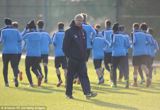Meanwhile.. Arsene Wenger oversees training in wintry conditions ahead of Arsenal's 11th game in six weeks