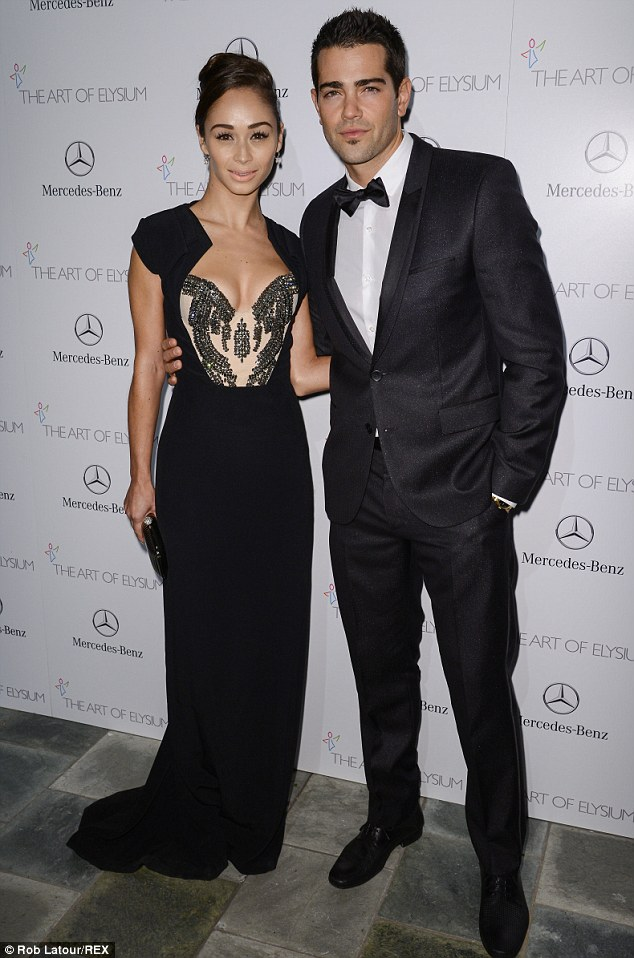 Glamming it up: Cara wore another stunning gown and Jesse donned a black suit for the Art Of Elysium Heaven Gala presented by Mercedes-Benz at the Skirball Centre in LA on Saturday