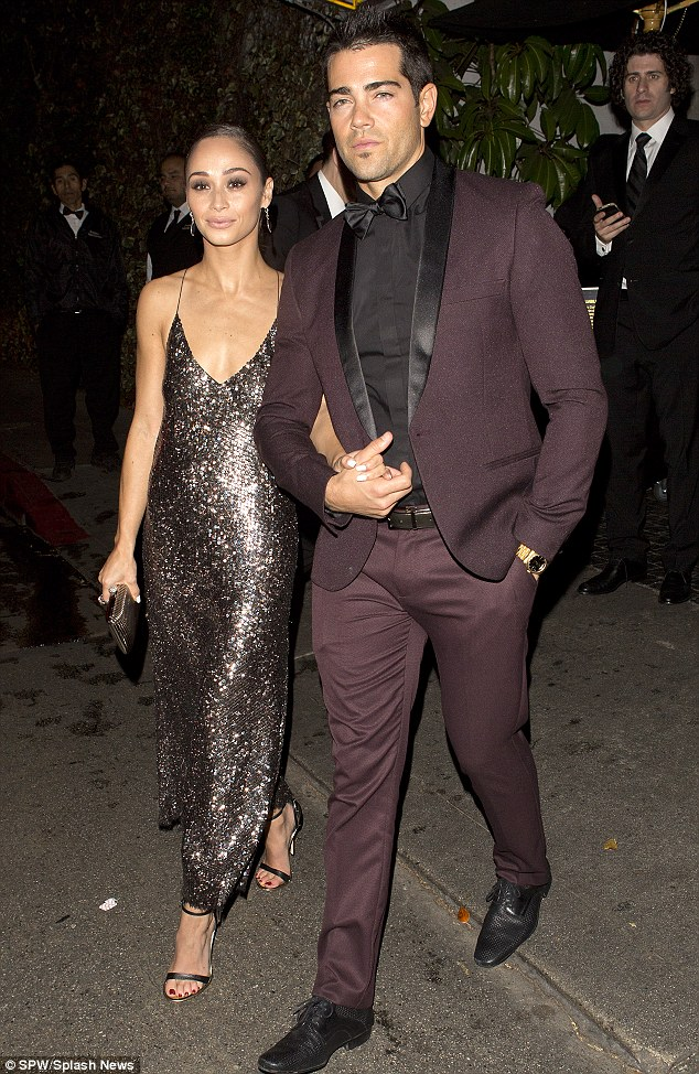 Super chic: Jesse Metcalfe lovingly holds fiancee Cara Santana's hand as they leave the WB/Instyle Golden Globes viewing party at the Chateau Marmont in West Hollywood on Sunday evening