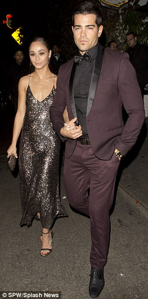Plum job: The 35-year-old Dallas star looked sharp in an aubergine-coloured suit with black lapels while the brunette beauty, 28, sparkled in a silver sequin gown