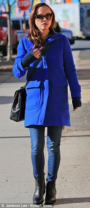 Nothing to be blue about: The star stood out in her striking cobalt blue woollen coat, which she wore over a navy blue long-sleeved jumper, jeans and black ankle boots, teamed with a cross-body black leather satchel and tortoiseshell shades