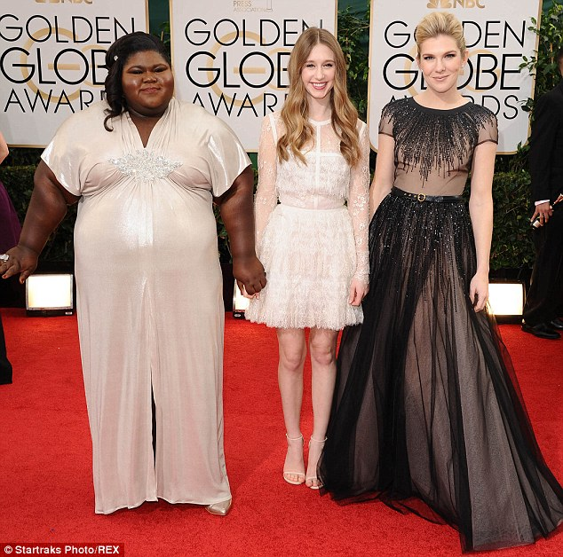 Coven of beauties: Gabourey posed on the Golden Globes red carpet with American Horror Story co-stars Taissa Farmiga and Lily Rabe