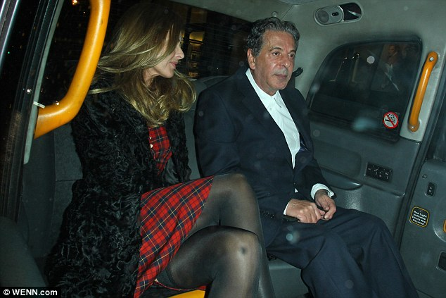 Time to leave: Trinny gazed over at Charles as they made their way out of Mayfair