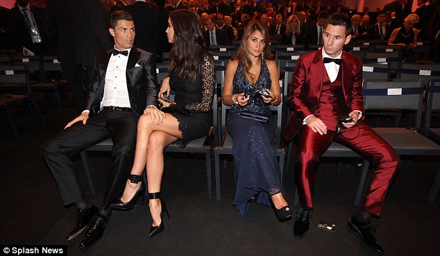 Setting the standard: Winner Cristiano Ronaldo (left), with girlfriend Irina Shayk (second left) andLionel Messi (right) with his wife Antonella at the Ballon d'Or