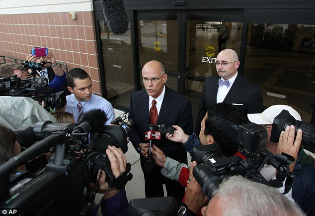 Richard Escobar, the attorney for Reeves, talks to reporters after his client's first hearing