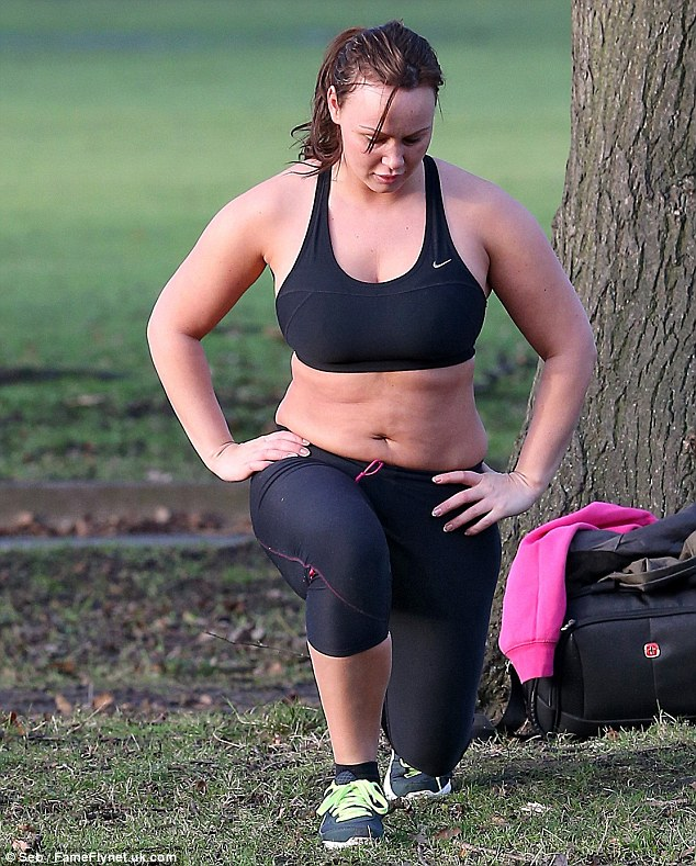 Taking the lunge plunge: Chantelle was put through her paces performing squats and lunges to tone her legs