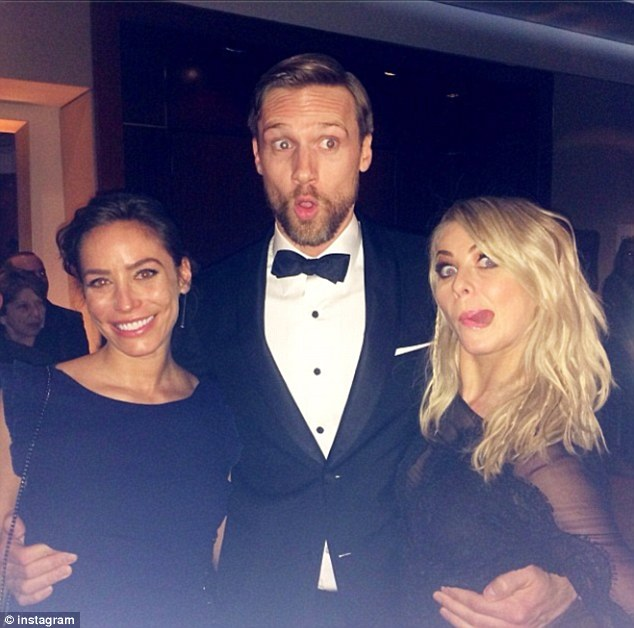 Where's Ryan? Julianne posted this picture of herself at the Globes with friends but did not mention her ex Seacrest
