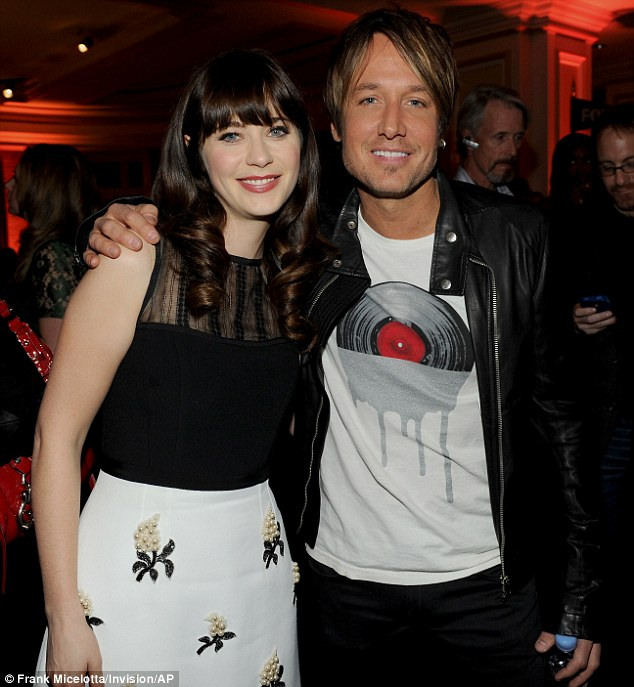 Rubbing shoulders: Zooey Deschanel chatted to Keith Urban later at the TCA party